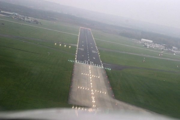 Runway 08 as we come out of the cloud into the drizzle
