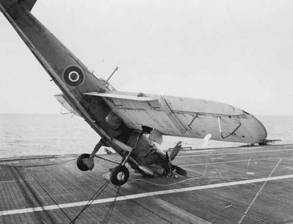 Fairey Barracuda II, LS691 of 768 Squadron, hitting the barrier and falls onto its nose on HMS Ravager, off the east Scottish coast, 12 July 1944