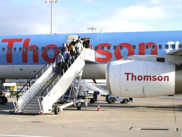 Passengers boarding a Thomson Fly B.757