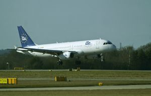 Airbus A320 Lte landing at Manchester