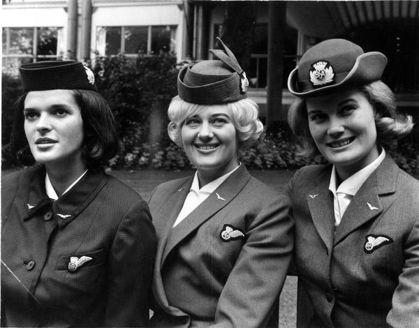 Marking 20th Anniversary of the formation of the British European Airways. The three uniforms that have been worn by BEA girls