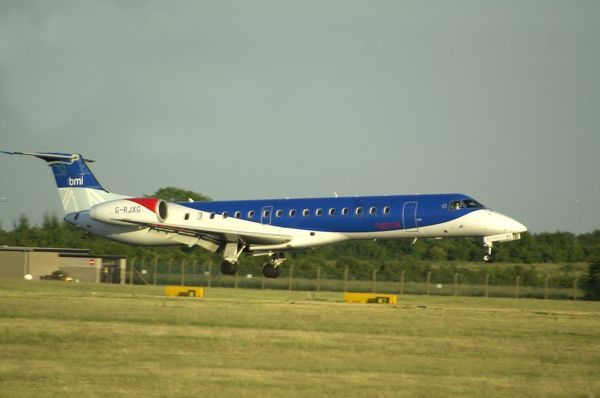 bmi commuter (British Midland Regional Ltd) Embraerer ERJ145EU (ex PY-SQO) landing ar Nema on midsummers evening