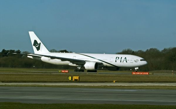 A PIA B777 starting take off run at manchester airport