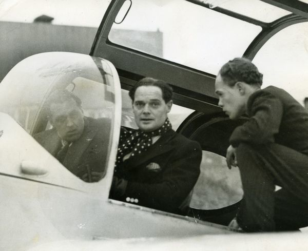 Captain D.R.S Bader, D.S.O and bar, D.F.C, in the pilots seat of a Miles Gemini, with S/Ldr