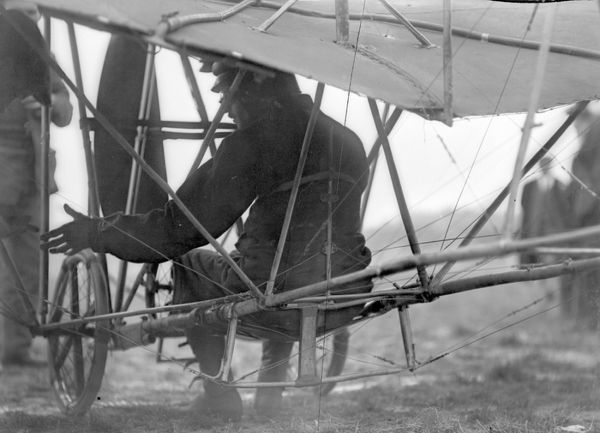 Edmond Audemars from Switzerland, sitting under his high-wing, wire-braced French Demoiselle monoplane, Bournemouth Meeting, July 1910