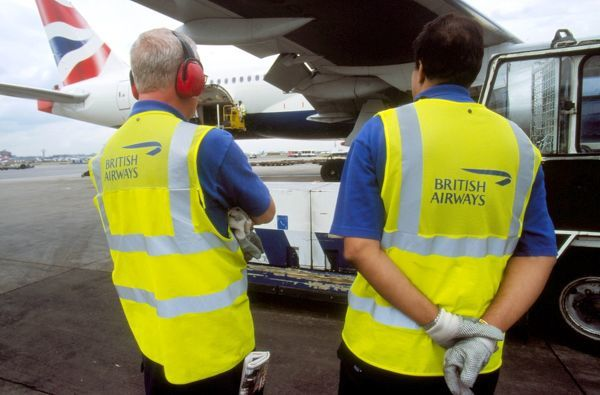 Ground Staff. yellow safety jackets ground crew ear defenders Ba 777 lhr edm