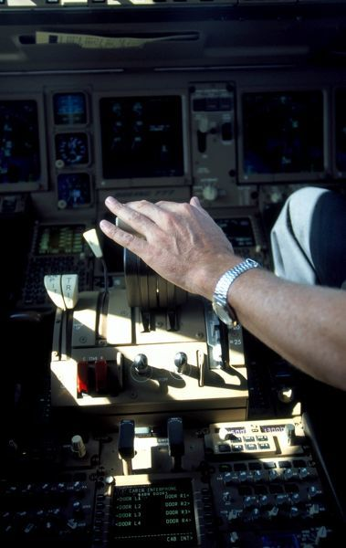 Hand on throttle. Co-pilot hand on throttleBoeing 777-200(c) WagnerThe Flight Colleciton