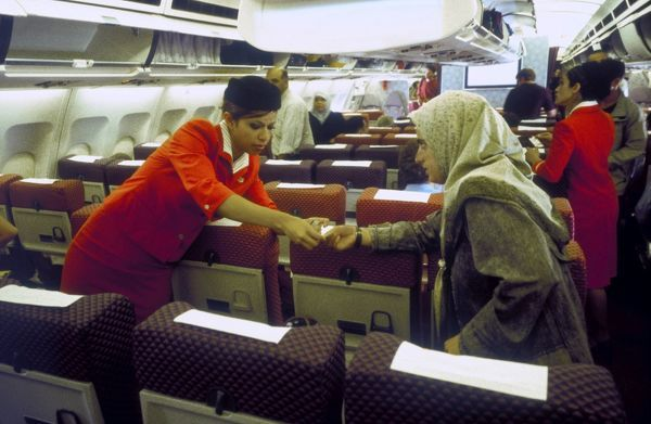 hoare A310-300 interior royal jordanian hostie helping person to right seat