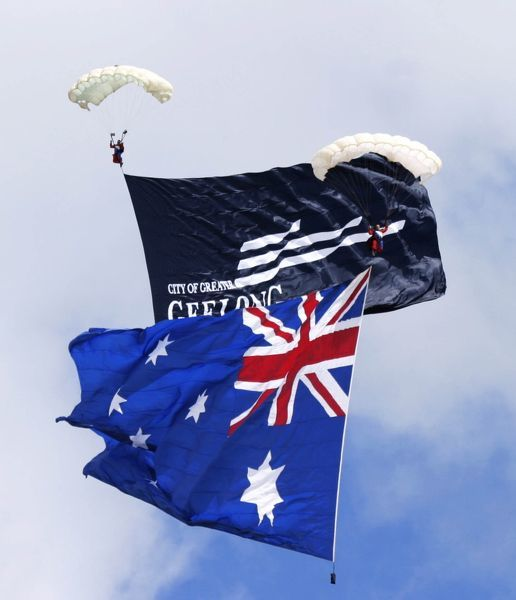 Two parachutists and flags