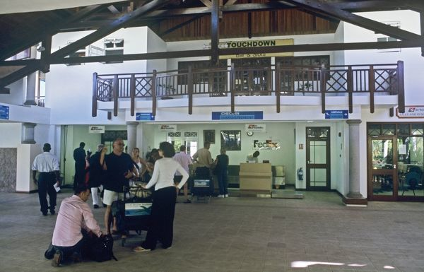 Passengers at check-in for domestic flight on Prasline Airport, Seychelles