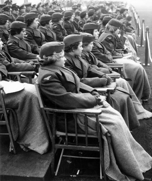 Members of the WRAF watch the Passing out Parade at Cranwell. Published 13/12/1960