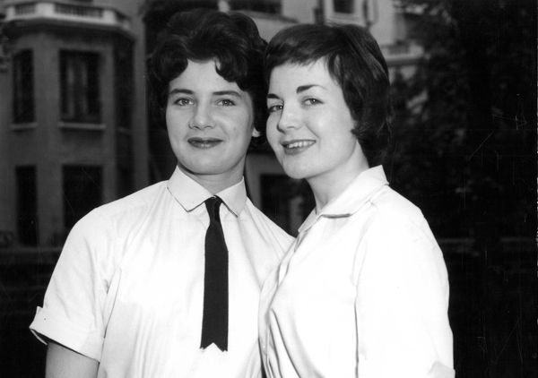 Two members of the Womens Royal Air Force model the new open neck summer blouse, being issued to all the airwomen in the United Kingdom at the WRAF hostel in Notting Hill Gate
