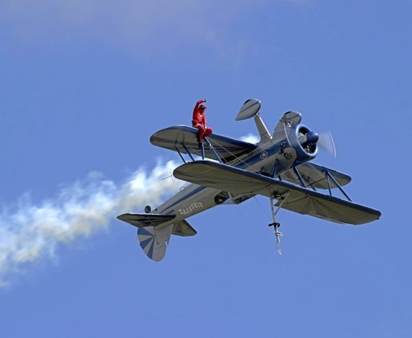 The inverted Stearman with the wingwalker on the lower wing
