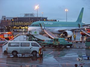 Airbus A320 Aer Lingus at Dubin Airport with evacuation slides deployed and fire service
