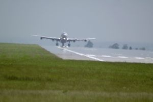 modern aircraft/airbus a340 300 taking off east midlands hot day