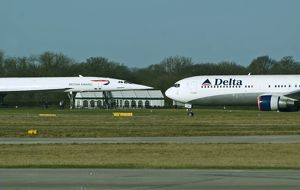 BAe Concorde now on display and Boeing 767 Delta at Manchester Airport