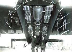 Crew of an RAF Halifax bomber load bombs, during World war Two