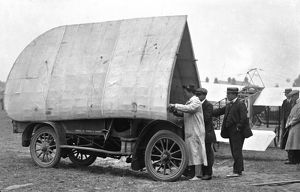 G.A. Barnes packs wings of Humber-Bleriot monoplane onto Humber car