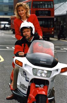 Richard Branson tries out his new motor cycle chauffeur service.