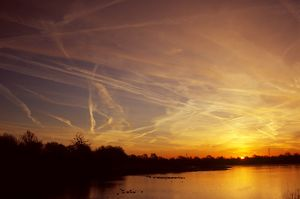 modern aircraft/sunrise contrails